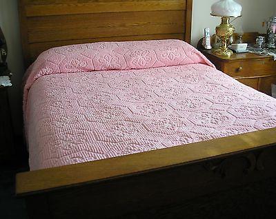 Pink vintage chenille bedspread
