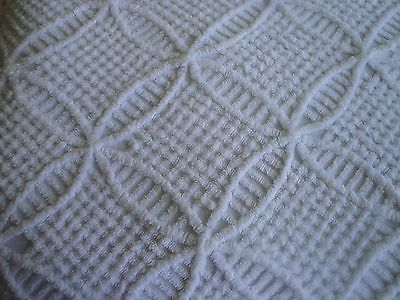 Close up of the wedding ring pattern on a vintage chenille bedspread.
